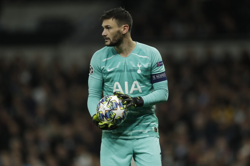 Tottenham's goalkeeper Hugo Lloris holds the ball during the Champions League group B soccer match between Tottenham and Bayern Munich at the Tottenham Hotspur stadium in London, Tuesday, Oct. 1, 2019. (AP Photo/Matt Dunham)