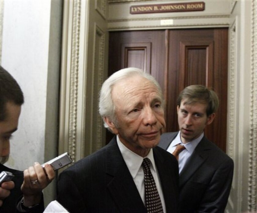 FILE - Sen. Joe Lieberman, I-Conn., pauses before heading into a Democratic caucus on health care reform in the Capitol in Washington, in this Nov. 18, 2009 file photo. On the Senate floor, Democrats are debating Republicans on health care. Behind the scenes, they're debating each other. Lieberman, a Connecticut independent, who has said he would filibuster the bill if a government option was included. He left a meeting early Thursday Dec. 3, 2009 and said his position hadn't altered. (AP Photo/Alex Brandon, File)