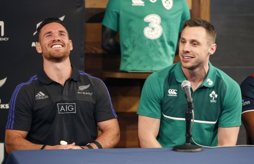 New Zealand All Blacks' Ryan Crotty, left, smiles at a remark made by Ireland's Tommy Bowe during a news conference at Chicago;'s Soldier Field Tuesday, Feb. 16, 2016, announcing that the All Blacks will play Ireland at the historic stadium in November. (AP Photo/Charles Rex Arbogast)