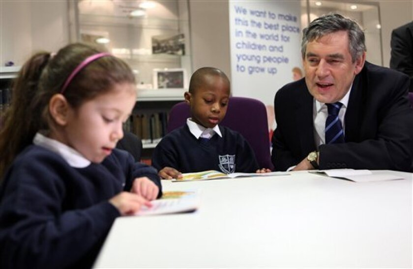 Britain's Prime Minister Gordon Brown meets school children from St Monica's Primary School in Hackney, east London. Monday Jan. 4, 2010. No date has been set, but campaigning has begun in Britain's 2010 national election. Prime Minister Gordon Brown and main opposition leader David Cameron were both making campaign-style announcements on education and health Monday, as they appeal to recession-weary voters to back them in an election that must be held by June. (AP Photo/Oli Scarff/PA)