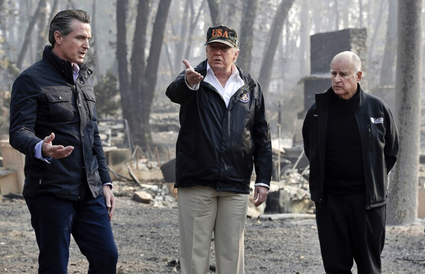 President Trump visits a neighborhood ravaged by the Paradise fire with Gov.-elect Gavin Newsom, left, and outgoing Gov. Jerry Brown in November.