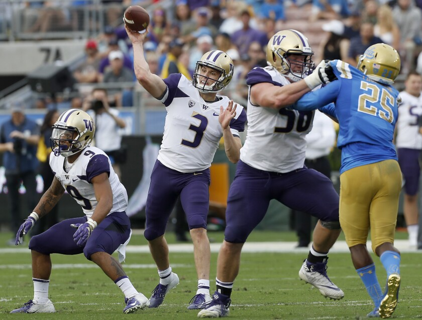 Washington quarterback Jake Browning throws downfield against UCLA at the Rose Bowl.
