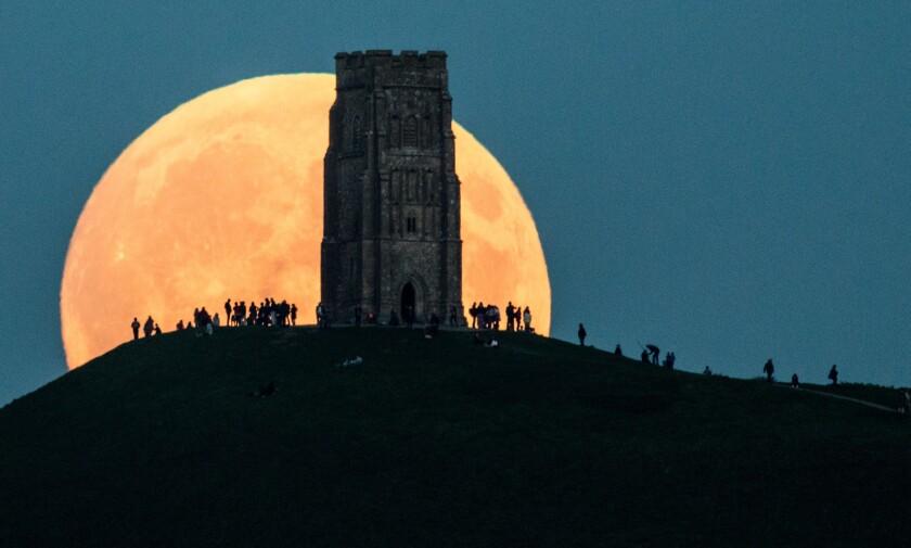 The moon rises behind Glastonbury Tor on September 27, 2015, in Glastonbury, England.