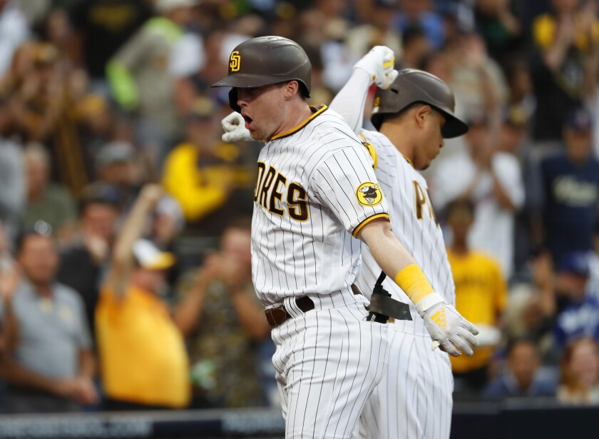 San Diego Padres' Jake Cronenworth celebrates with Manny Machado