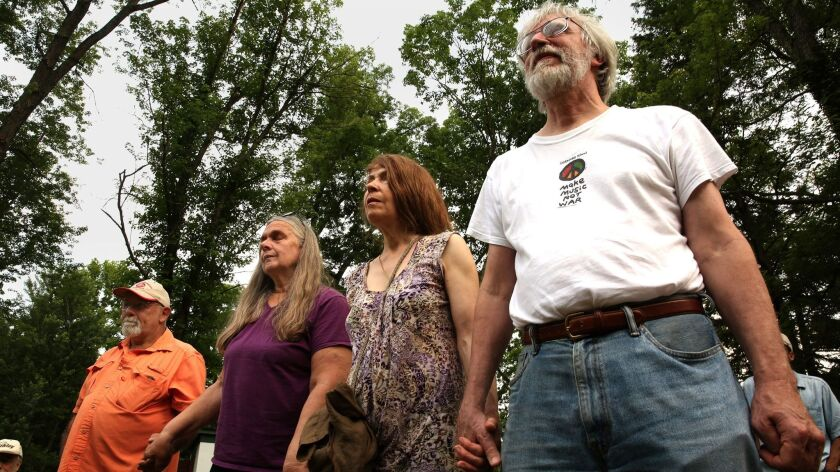 PENCE SPRINGS, WEST VIRGINIA--JUNE 11, 2017--A group of concerned citizens gather near the Greenbrie