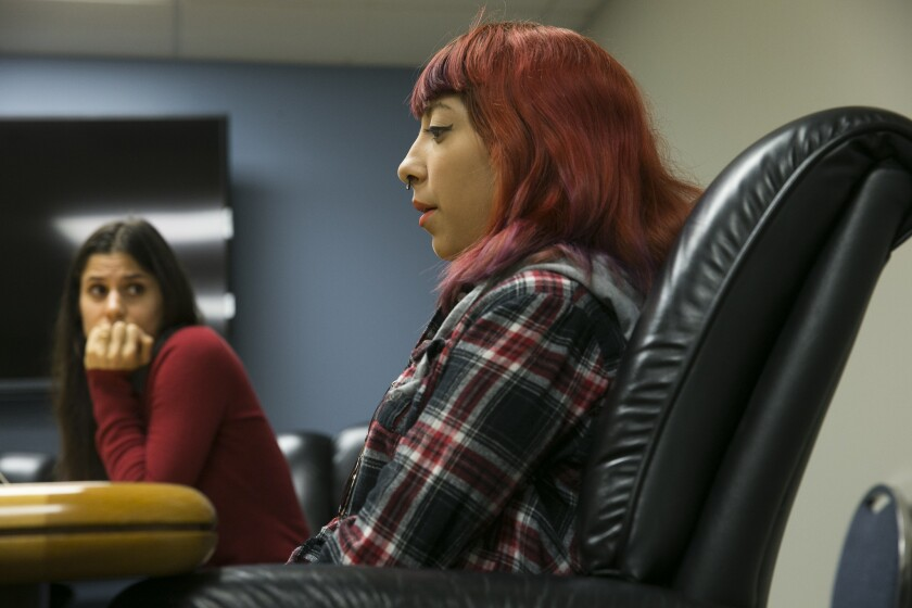 Compton Unified student Kimberly Cervantes is part of a class action lawsuit seeking academic and counseling services from the Compton Unified School District. Attorney Annie Hudson-Price looks on.