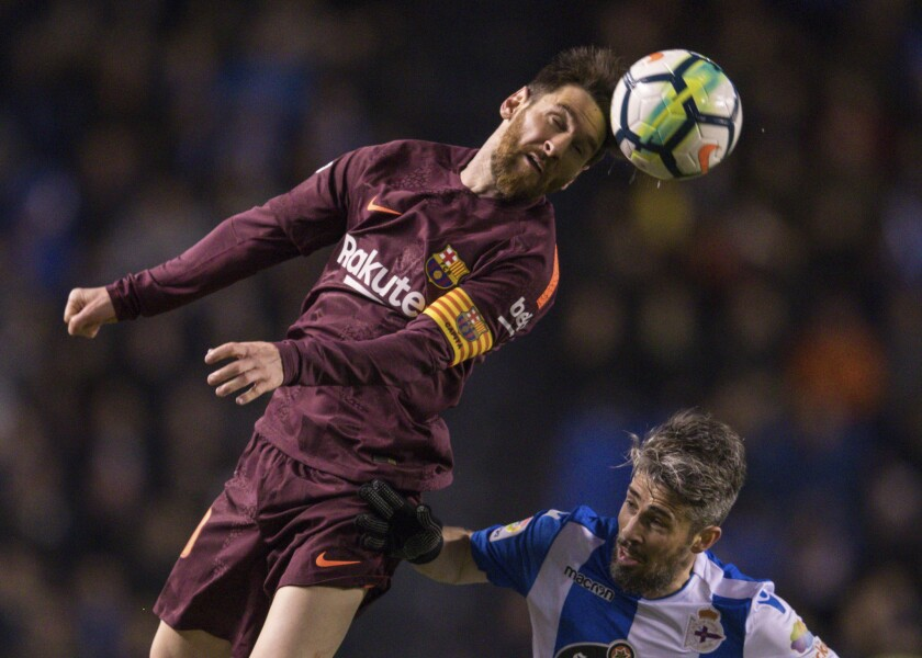 Argentine Lionel Messi, left, who plays for Barcelona, vies with Deportivo's Luisinho for the ball during a soccer match in A Coruna, Spain, on April 29, 2018.
