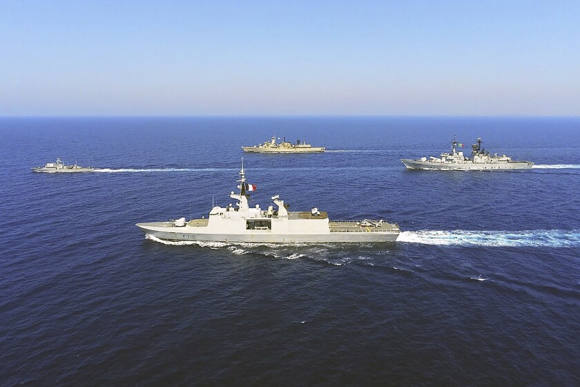 """In this photo provided on Monday, Aug. 31, 2020, by the Greek Defense Ministry, warships from Greece, Italy, Cyprus and France, participate in a joint military exercise which was held from 26-28 of August, south of Turkey in eastern Mediterranean sea. Turkey on Monday, Aug. 31, accused Greece of """"piracy"""" and warned it will stand up to Athens' alleged efforts to militarize islands near its coast. (Greek Defense Ministry via AP)"""