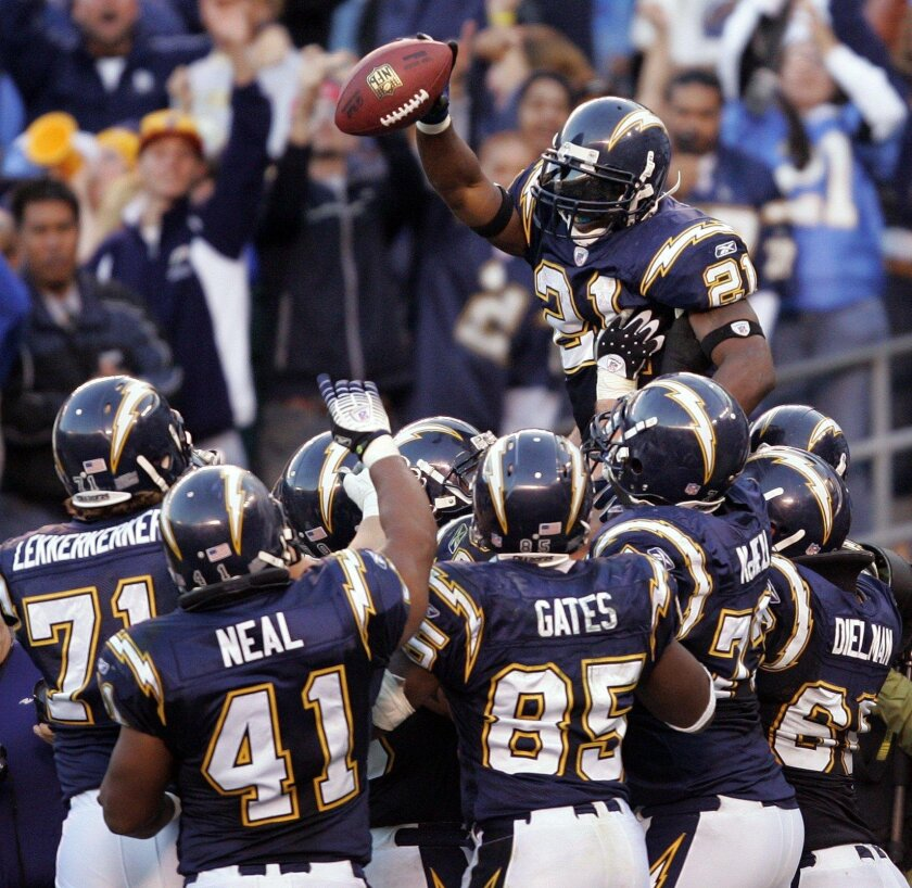 LaDainian Tomlinson celebrates on the shoulders of teammates after setting the NFL record for touchdowns in a season on Dec. 10, 2006.