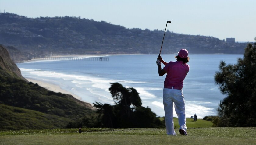 Rickie Fowler tees off on the sixth hole of Torrey Pines North.