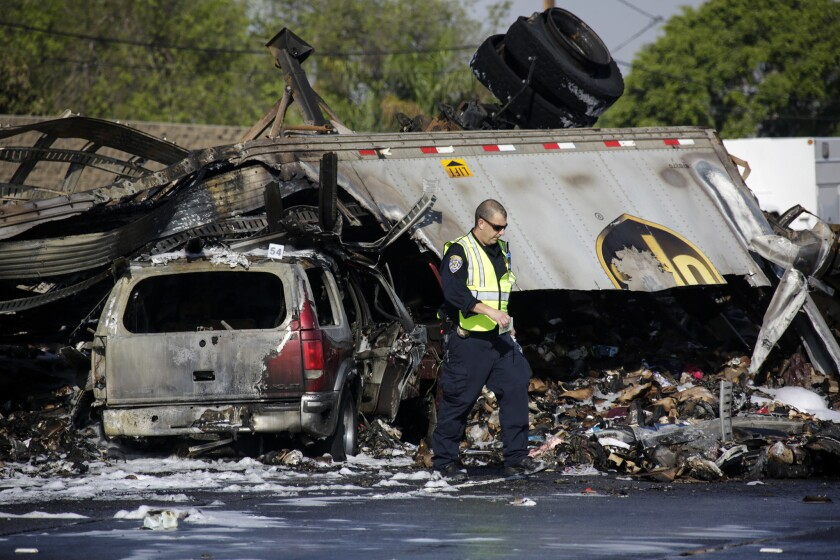 California Highway Patrol officials investigate at a fiery crash in Commerce in 2016 that left three people dead. Street racing was believed to be a factor, and a man is awaiting trial on murder charges in connection with the crash.