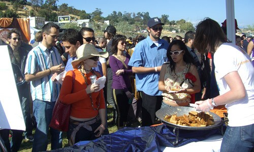 A volunteer from Kraft hands out free sandwich bites at the 2009 Grilled Cheese Invitational.