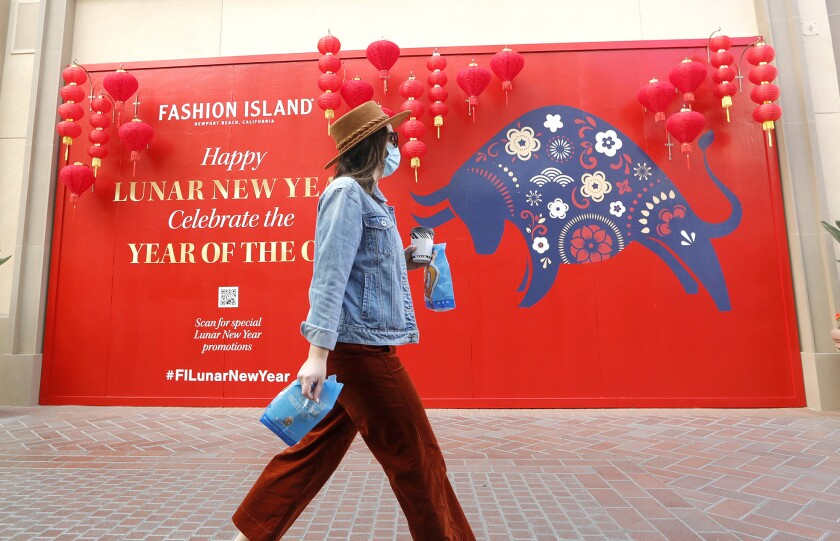 A shopper at Fashion Island earlier this year.