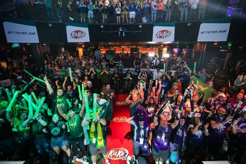 Fans cheer on for The Gladiators and Valiant, Los Angeles' two Overwatch League teams at The Novo at L.A. Live.