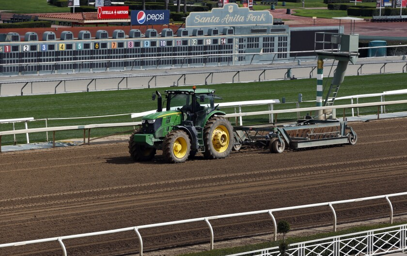 A tractor grooms the dirt track at Santa Anita Park in Arcadia, Calif., Thursday, March 7, 2019. Extensive testing of the dirt track is under way at eerily quiet Santa Anita, where the deaths of 21 thoroughbreds in two months has forced the indefinite cancellation of horse racing and thrown the workaday world of trainers, jockeys and horses into disarray.