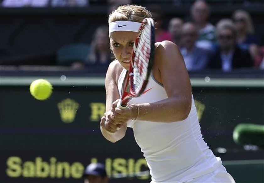 Sabine Lisicki of Germany returns to Agnieszka Radwanska of Poland during their Women's singles semifinal match at the All England Lawn Tennis Championships in Wimbledon, London, Thursday, July 4, 2013. (AP Photo/Anja Niedringhaus)