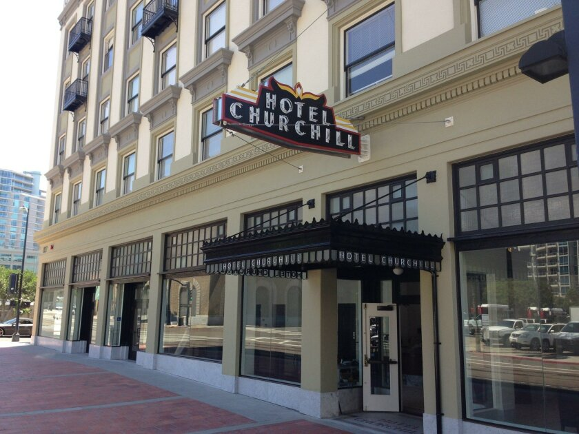 The Churchill Hotel, reopening this week as an affordable apartment project, is one of more than two dozen projects under way downtown.