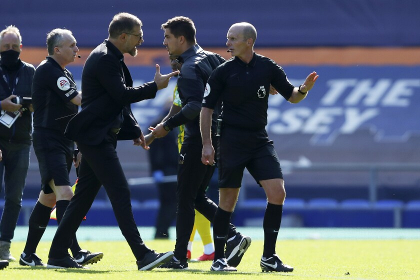 West Bromwich Albion's manager Slaven Bilic, 3rd left, argues with Referee Mike Dean before being sent off during the English Premier League soccer match between Everton and West Bromwich Albion at Goodison Park in Liverpool, England Saturday, Sept. 19, 2020. (Alex Livesey/Pool via AP)