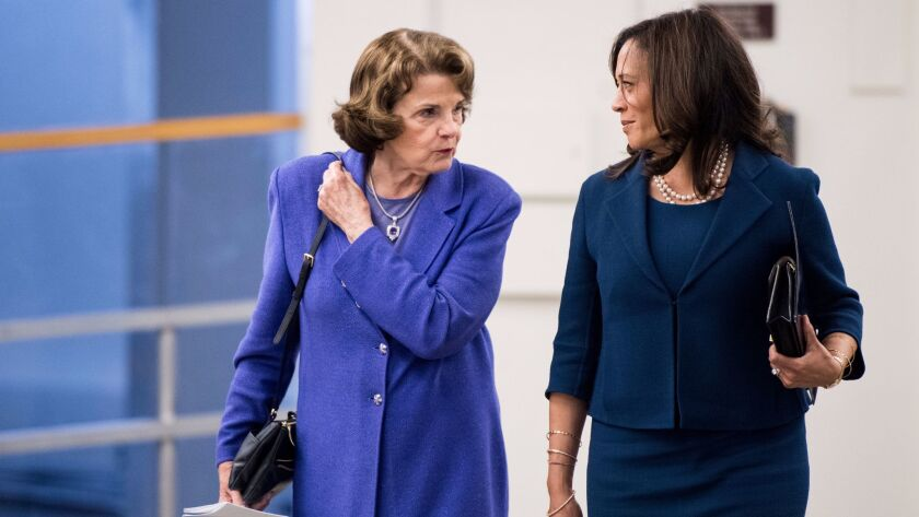 Sens. Dianne Feinstein and Kamala Harris, both D-Calif., arrive in the Capitol for a vote on Sept. 7.