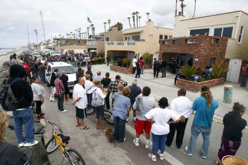 People gather outside the home of Junior Seau on Wednesday.