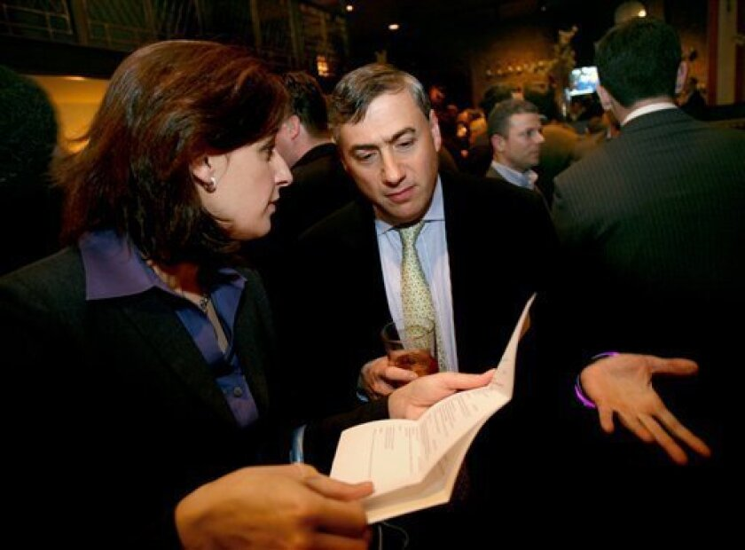 Alex Silverman of Great Neck, NY, who lost his job 14 months ago at WaMu Capital Corp., speaks with recruiter Julia Kaufmann-Yu of High Impact Coaching at the Wall Street Pink Slip Party for Wall Street job seekers and recruiters at the Public House New York Tuesday, Nov. 11 2008. (AP Photo/Craig Ruttle)