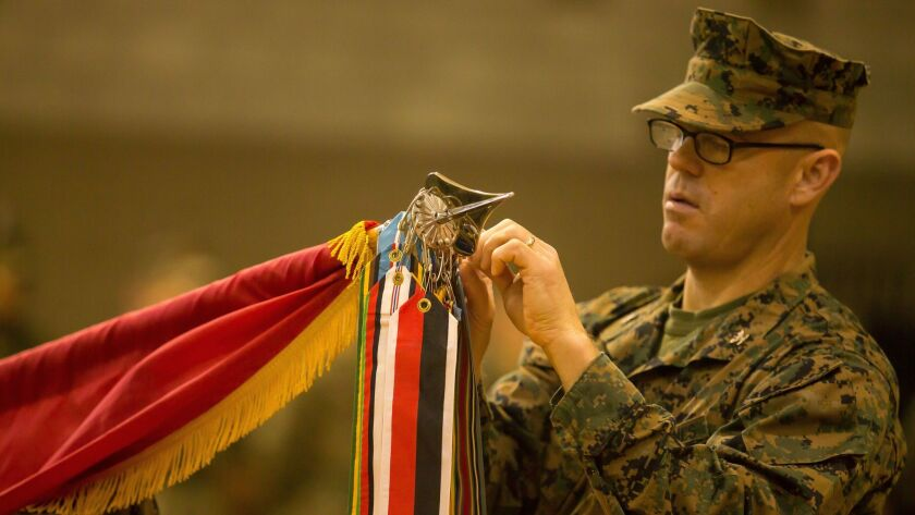 Marine Corps Col. William Field, the commander of the 11th Marine Regiment, rededicates the unit's battle streamers during a centennial ceremony on Camp Pendleton on Tuesday.