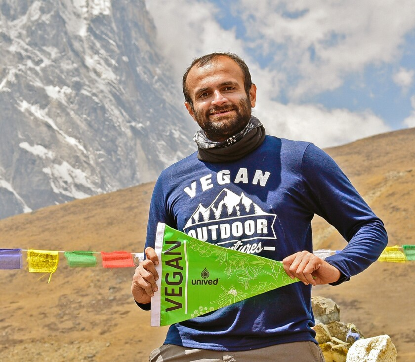 Mountaineer, photographer and avalanche survivor Kuntal Joisher will speak Friday at REI in Huntington Beach and Saturday during VegFest at Orange Coast College about his recent summit to Mt. Everest, marking the first time a vegan has reached the mountain's elusive peak.