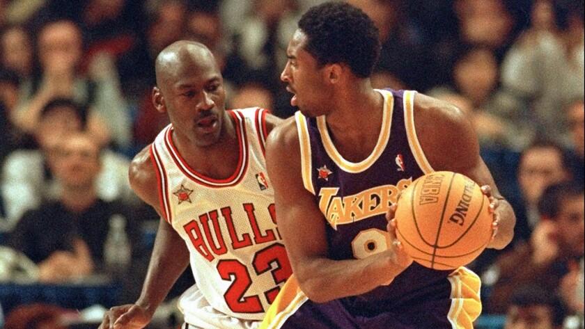 Chicago Bulls great Michael Jordan, left, guards Lakers star Kobe Bryant during the 1998 NBA All-Star game.