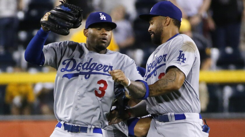 Dodgers outfielders Carl Crawford, left, Andre Ethier, center, and Matt Kemp celebrate after a win over the Pittsburgh Pirates on July 21. Will there be fewer outfielders on the Dodgers' roster by the trade deadline?