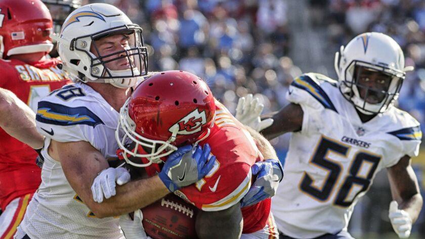 Chargers linebacker Nick Dzubnar tackles Chiefs kick returner Tyreek Hill at StubHub Center.