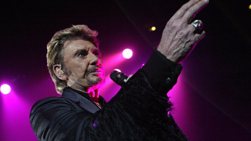 French singer Johnny Hallyday performs in 2003 in Clermont-Ferrand.
