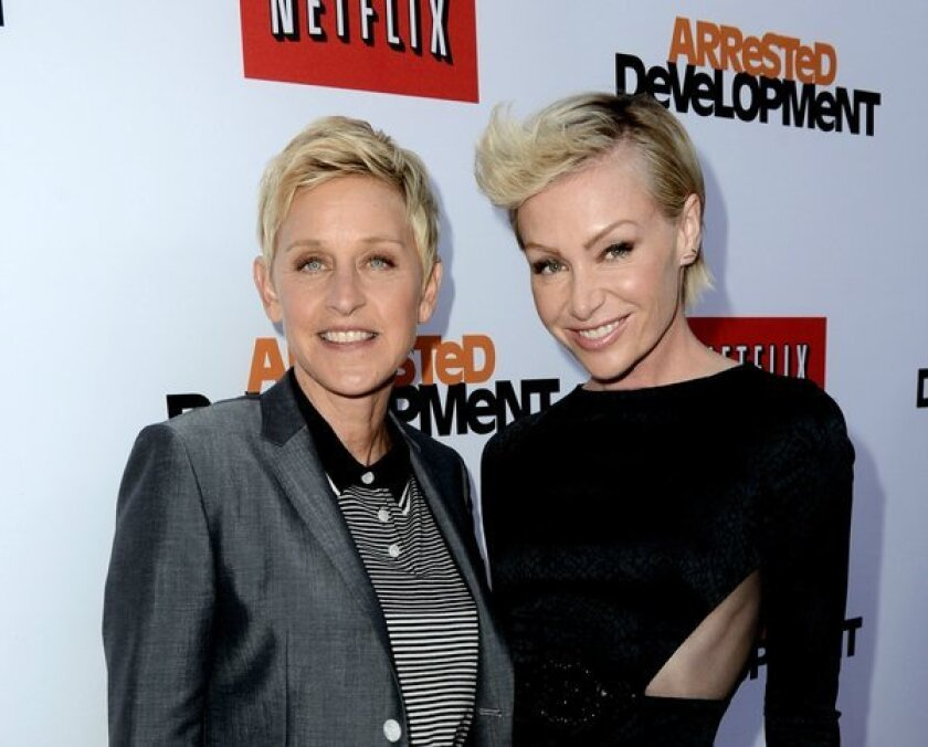 """Ellen DeGeneres, left, and actress Portia de Rossi are adding a 13-acre estate in Montecito to their list of Southern California properties. Above, they attend the premiere of Netflix's """"Arrested Development"""" Season 4 at the Chinese Theatre."""