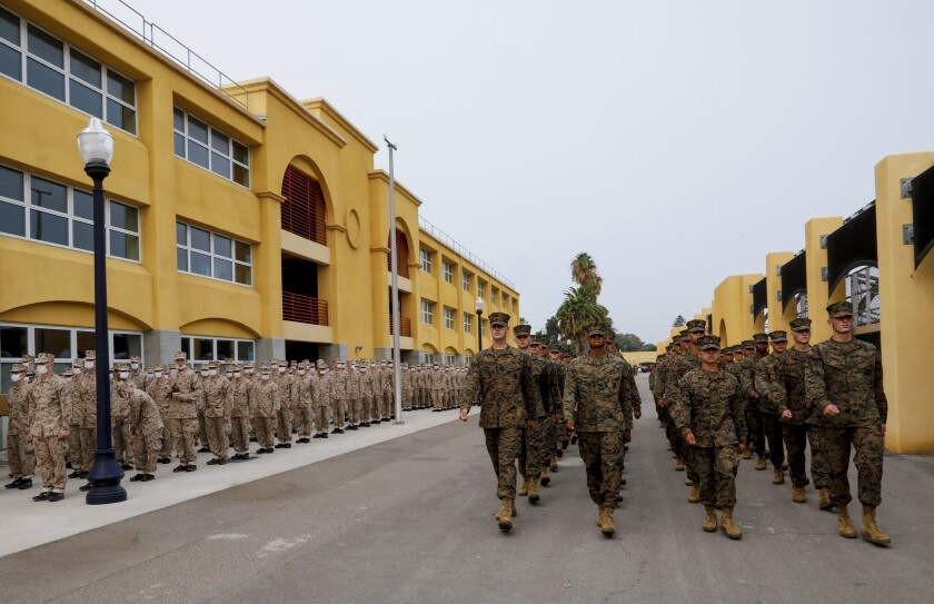 Marines of Alpha Company, 1st Recruit Training Battalion, march in formation during a graduation ceremony