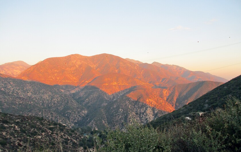 "As the sun drops, each ridge in turn loses its radiance and ""leaves the world to darkness and to me,"" Reg Green writes."