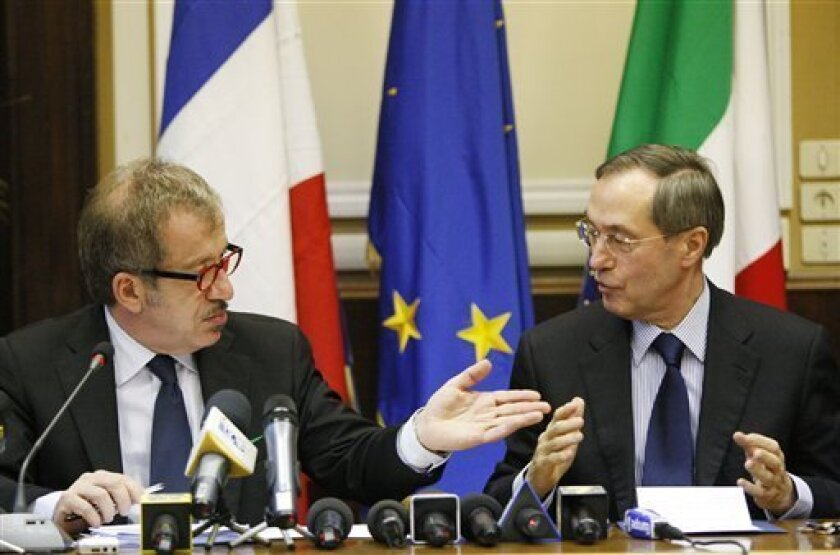 Italy's Interior Minister Roberto Maroni, left, speaks with France's Interior Minister Claude Gueant during a press conference at Milan's government office, Italy, Friday, April 8, 2011. Italy and France agreed on Friday to carry out joint sea and air patrols to try to block more Tunisian migrants from sailing to European shores, the Italian interior minister said after meeting his French counterpart. (AP Photo/Antonio Calanni)