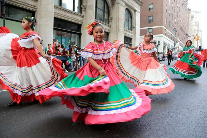 Girls dance on Madison Avenue during the annual Mexican Day Parade in 2016.