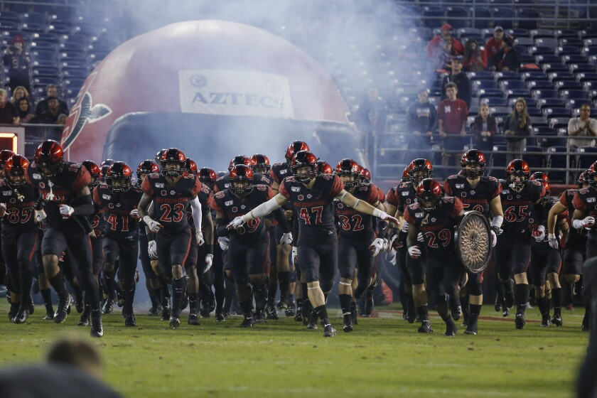 San Diego State players run onto the field during introductions before last week's 17-7 home win over Fresno State.