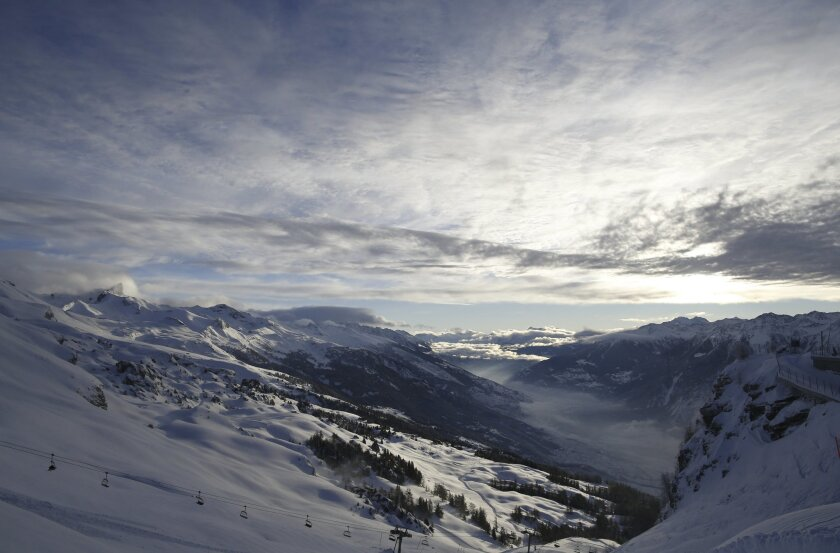 Clouds hang over the valley after an alpine ski, women's World Cup downhill race was canceled following a heavy snowfall, in Crans Montana, Switzerland, Saturday, Feb. 13, 2016. (AP Photo/Alessandro Trovati)