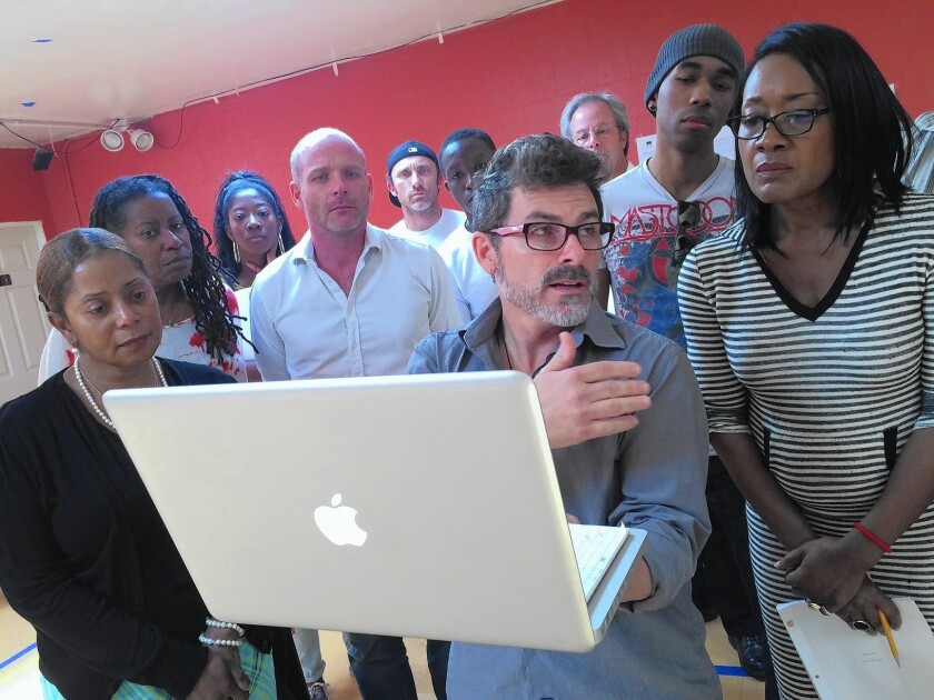 """Director Nick DeGruccio discusses the play """"Ferguson,"""" by Phelim McAleer, with actors during rehearsal. Some cast members have quit in protest over the play's depiction of Michael Brown's shooting by a Missouri police officer."""
