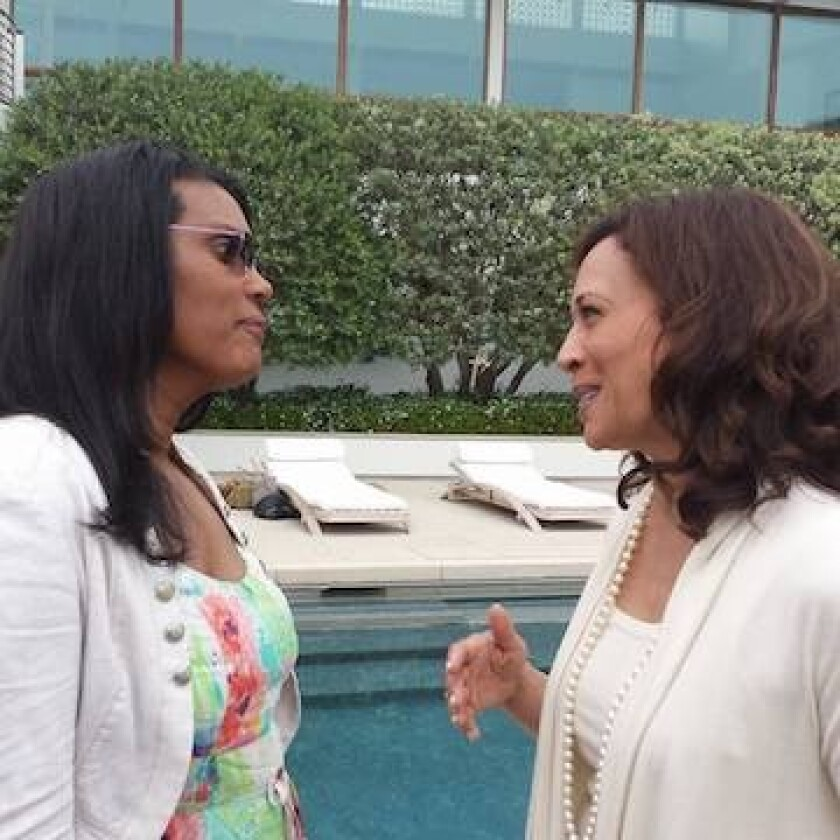 Angela de Joseph talks with Kamala Harris in Malibu in 2013 at a fundraiser.