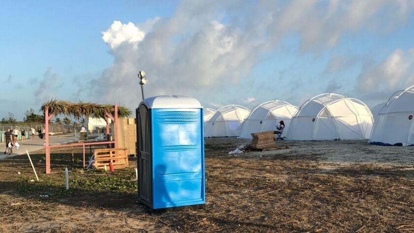 Amenities for patrons at the Fyre Fest on Exuma included tents and a portable toilet.