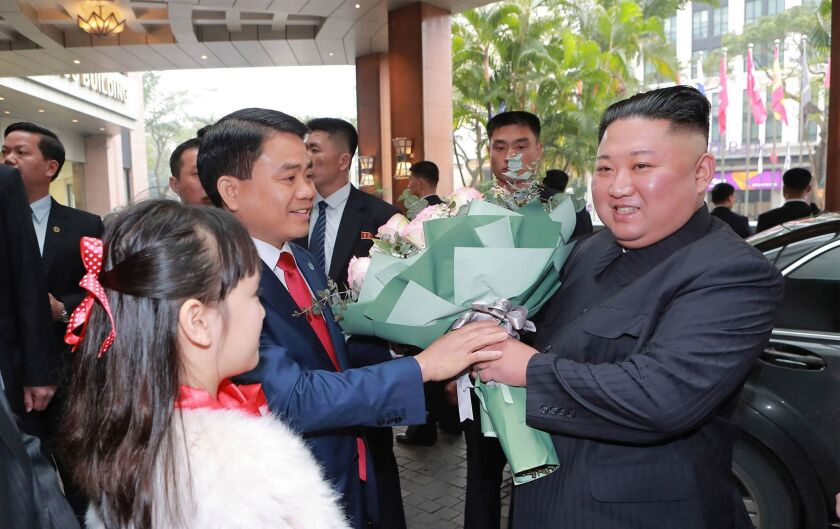 North Korean leader Kim Jong Un is welcomed upon his arrival at a hotel in Hanoi.