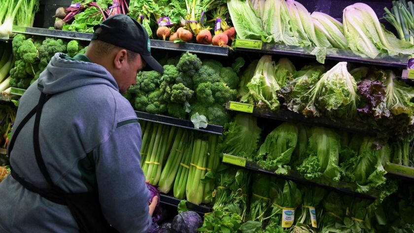 A produce worker stocks shelves at a Whole Foods supermarket in Washington, D.C. The FDA inspects around 80% of the country's food supply, including fruit and vegetables, bottled water, cheese and prepackaged goods.