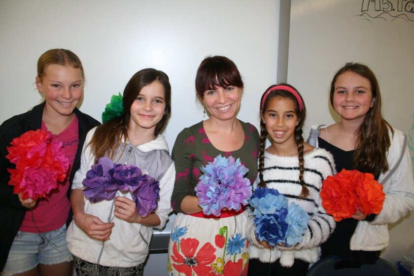 R. Roger Rowe middle school art students with teacher Marika Fagan displaying their floral décor for the Jan. 27 Empty Bowls dinner. Photo by Karen Billing