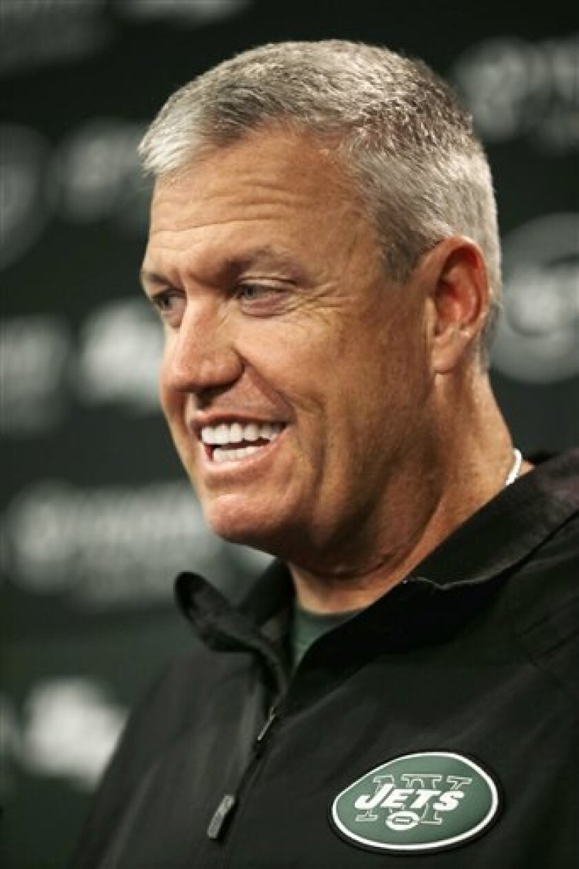 New York Jets head coach Rex Ryan smiles as he answers a question after the team's NFL football practice in Florham Park, N.J., Monday, Sept. 2, 2013. (AP Photo/Mel Evans)