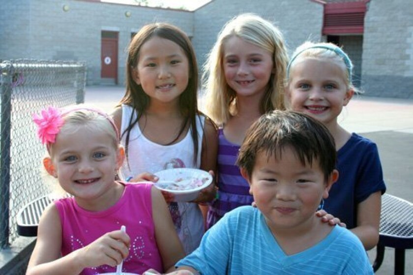 Natalie Wang, Amanda Schlesener and Taylor Rohrbach with (front row) Reese Rohrbach and Aaron Wang.
