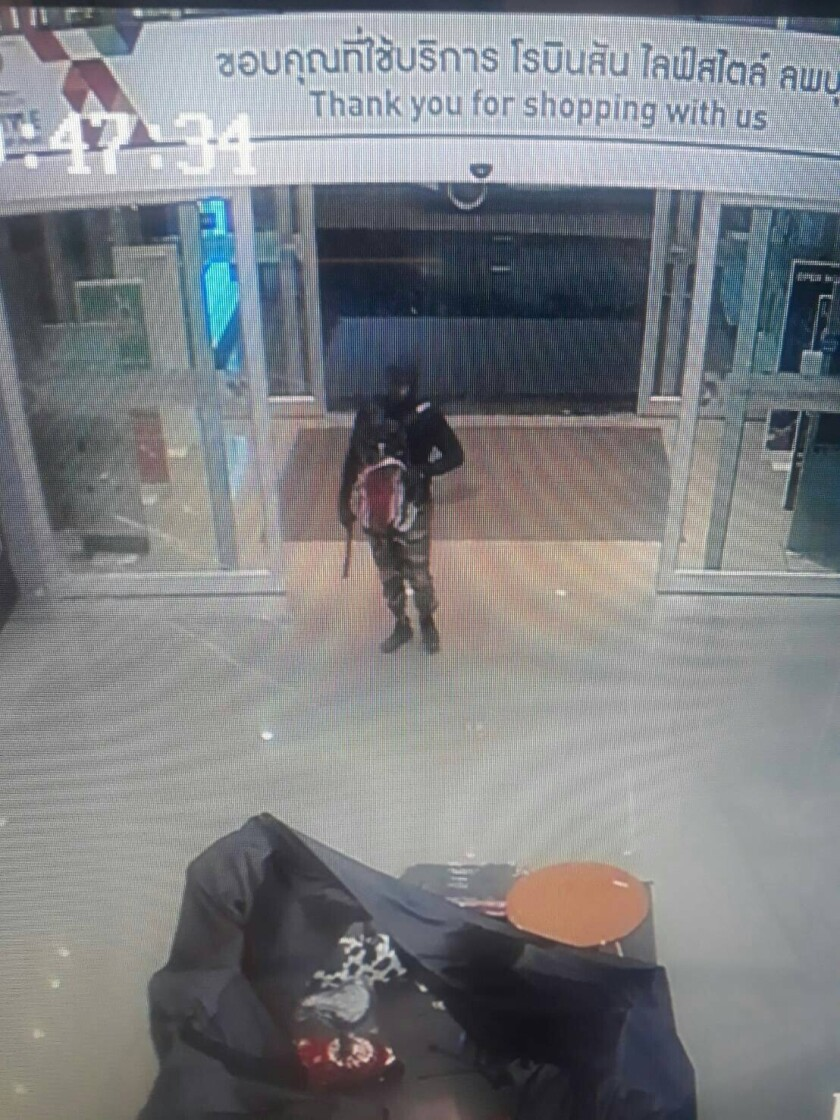 This Thursday, Jan. 9, 2020, image made from a security camera video and provided by Royal Thai Police Crime Suppression Division, shows a person alleged to have shot dead people at a gold shop robbery in a mall in Thailand's central province of Lopburi. Thai police were hunting Friday, Jan. 10, for a masked assailant who went on a shooting spree at a shopping mall, killing three people and wounding others as he robbed a jewelry store. (Royal Thai Police Crime Suppression Division via AP)