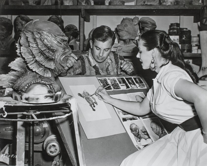"Designer Milicent Patrick sketches the ""Creature From the Black Lagoon,"" as seen in the exhibition ""The Natural History of Horror."""