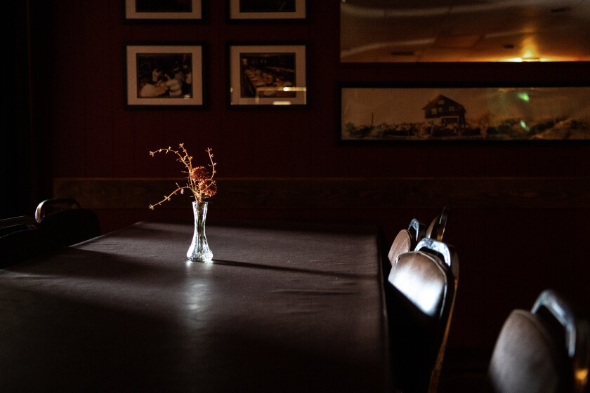 The communal tables are empty at Centro Basco, an historic Basque restaurant in Chino.