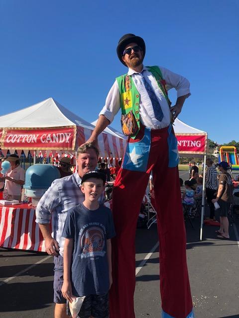 Stilt man with DMUSD board member Steve Cochrane and Christopher Cochrane